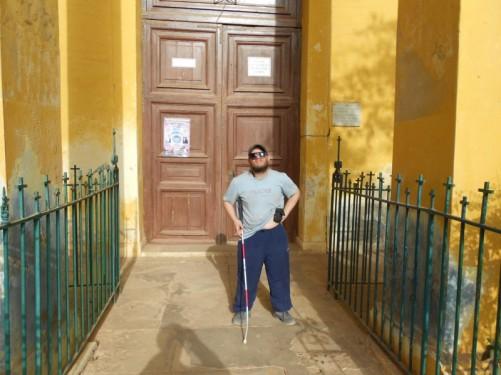 Tony outside the door to the Catholic church.