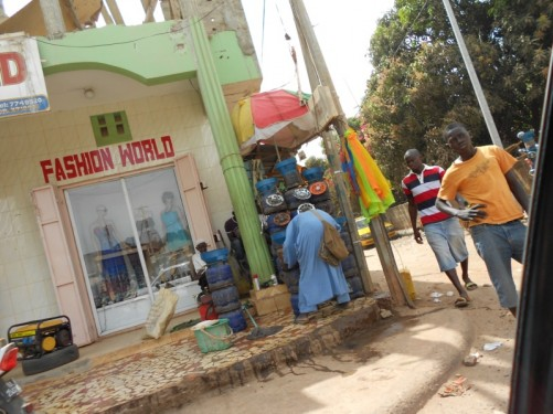 Another street scene. Gas bottles for sale and a clothes shop behind.