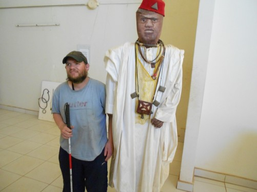 Inside a museum at the top of the arch. Tony beside a mannequin dressed in a traditional white robe.