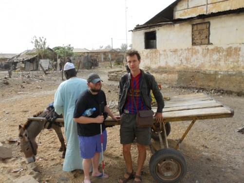 Tony and the Slovakian guy waiting by a donkey cart in Kuntaur village.