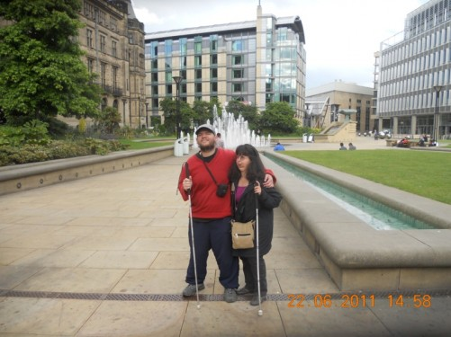 Tony and Tatiana at the Peace Gardens. The Town Hall is on the left.