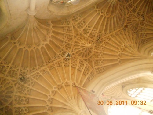Looking up at the elaborate carved-stone ceiling of the abbey.