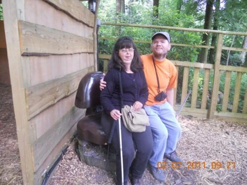 Tony and Tatiana sitting on a bench.