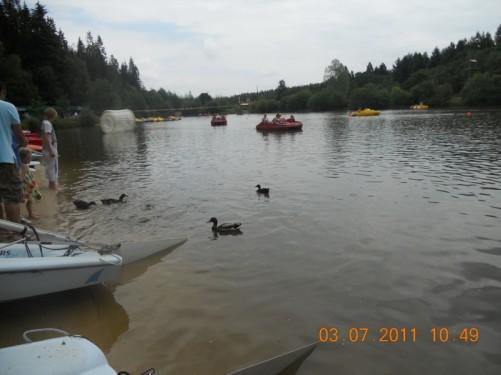By a lake. Ducks. Pedalo boats.