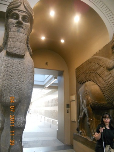 Pair of huge Assyrian Winged Bull statues with human heads.