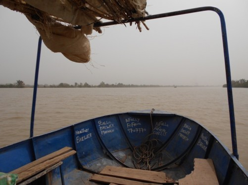 View along the wide river from the boat's bow.