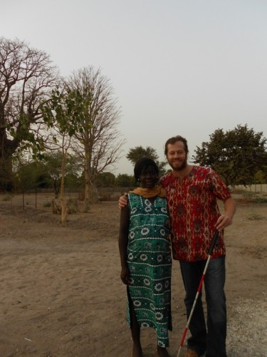 Simon with his Senegalese partner Khady, near their house. Photo taken by Tony.