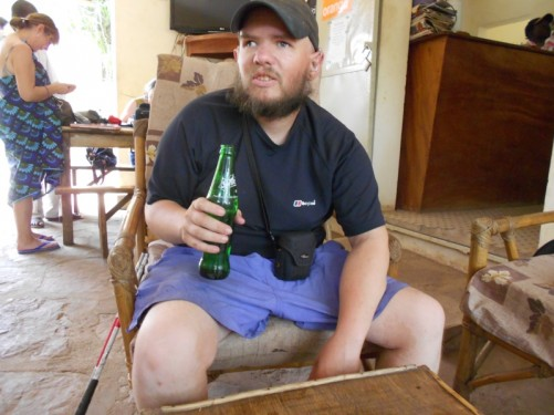 Tony with a bottle of Sprite at The Sleeping Camel Guesthouse, Bamako.