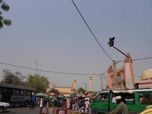 Looking towards the edge of a busy market. The two minarets of the Grand Mosque are visible behind.
