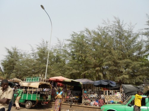 Market stalls selling clothes at the roadside.