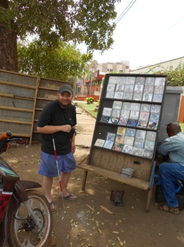 Tony at a street stall selling CDs of African music.