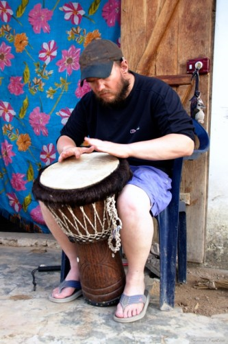 Tony playing a djembe (drum), Abene centre.