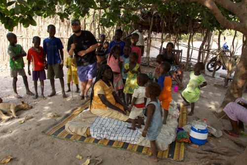 Tony with Khady and a large group of children (about 20) in Madina Dafe village.
