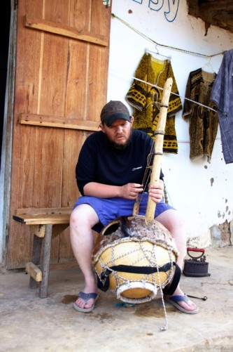 Tony playing kora (West African harp), Abene centre.