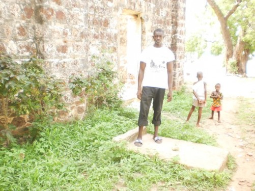 Saigou again by the old wall. Two young children standing a little way behind him.