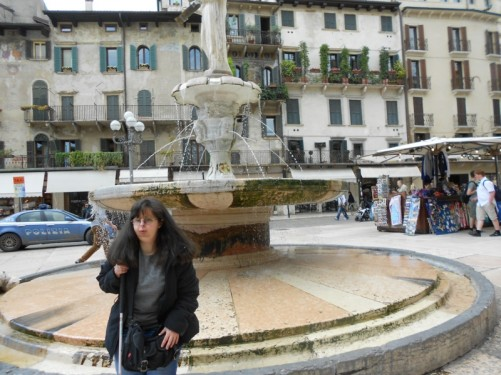 Tatiana by the fountain in Piazza delle Erbe.