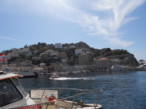 An attractive view of Hydra town raising up above the harbour.