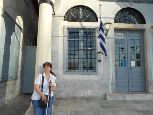 Tatiana outside a building. Hellenic Postbank.