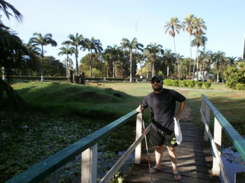 Tony standing on a bridge over a lake in the Botanical Gardens.