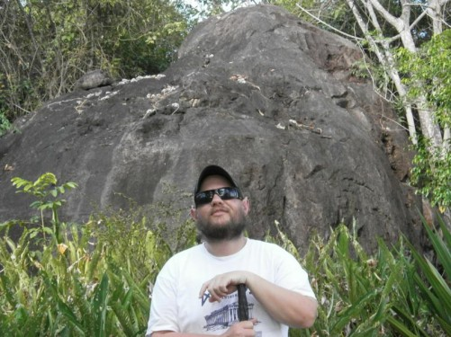 Close-up of Tony with the rocky outcrop behind him.