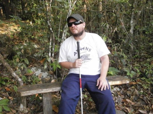 Tony sitting on a bench on the Uncle Dennis Trail near Rock View Lodge.