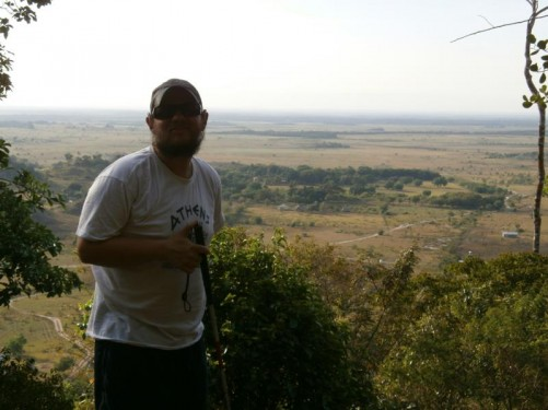 Tony with the savannah down below behind him.