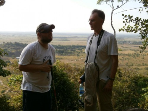View of the savannah. Tony with a man holding a camera and binoculars. He's a visitor from Essex, England.