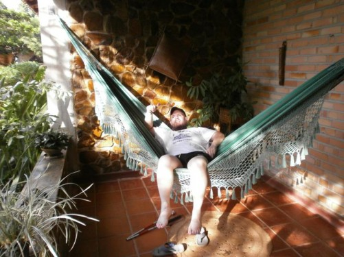 Tony leaning back in a hammock on his verandah.