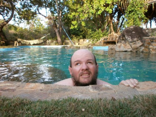 Tony at the side of the swimming pool.