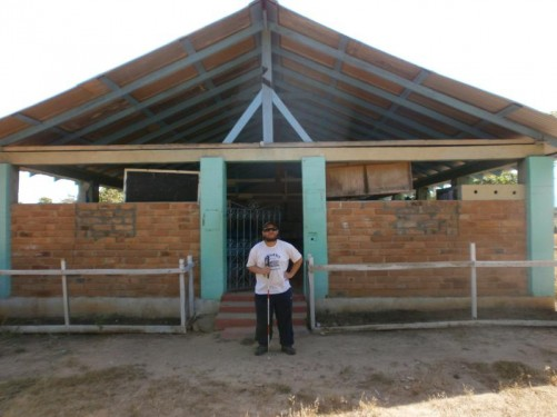 Tony outside the small village school.
