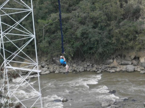 Tony dangling on the bungee cord above the Rio Fonce.