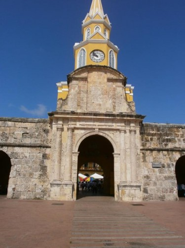 The Clock Tower (Torre del Reloj) at the official entrance to the Old Town called Clock Gate (Puerta del Reloj). It connects with the Square of the Carriages (Plaza de los Coches).