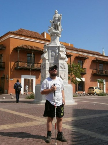 Tony in front of a statue of Christopher Columbus in Plaza de la Aduana (Customs Square).
