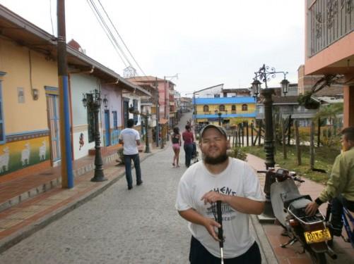Tony on a long narrow cobbled street in Guatapé.