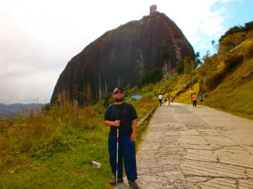 Tony on a road leading towards the rock.