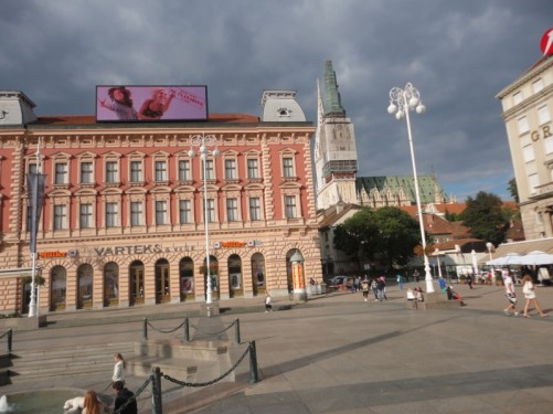 A view of the Cathedral looking from Jelacic Square. The sky above is filled with dark cloud suggesting imminent rain.