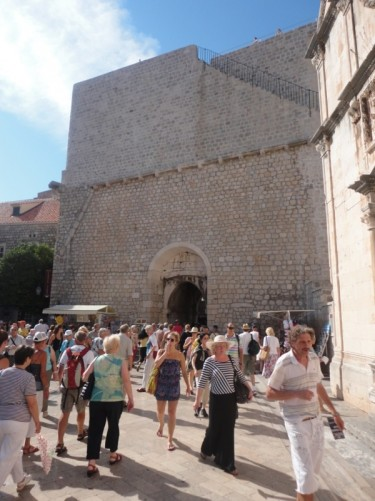 The inside of Pile Gate. Crowds of visitors entering and leaving the walled old town.