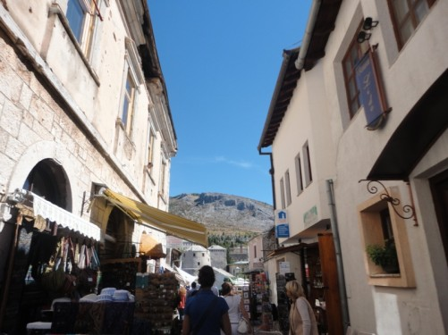 Busy, narrow street in the old town lined with souvenir shops.
