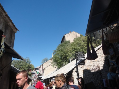 Street through the old town crowded with visitors.