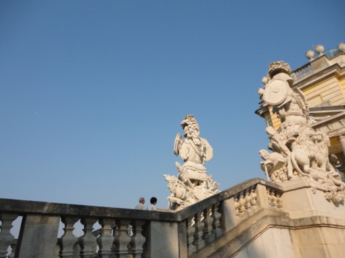 Sculptures at the top of stone steps leading to the Gloriette.