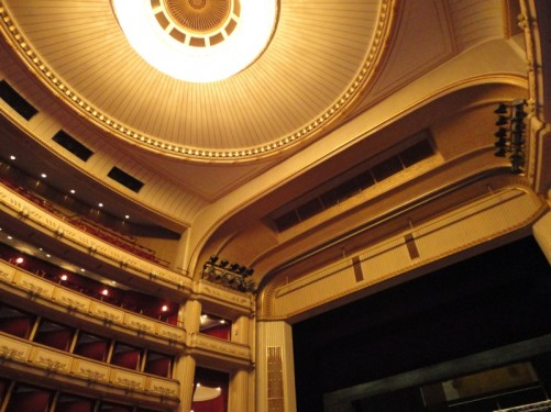 View of the ceiling and balconies inside the auditorium of the Vienna State Opera.