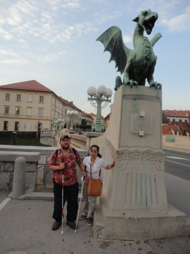Tony and Tatiana at Dragon Bridge. One of the four bronze dragons that sit on stone pillars at either end can be seen. The bridge was constructed in 1888, but the dragons weren't added until 1901.