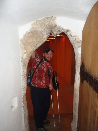 Tony standing in a stone doorway inside the castle.