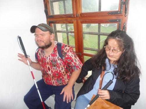 Tatiana and Tony sitting at a window.