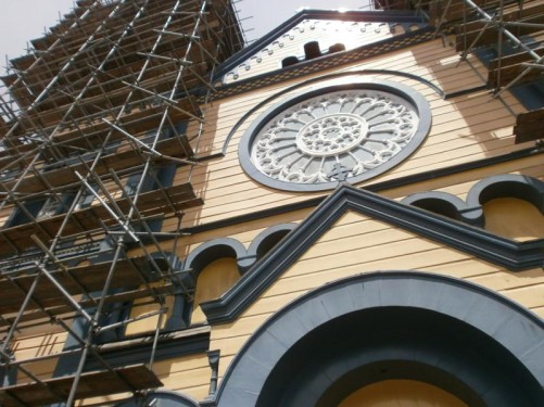 Looking up at the front of the cathedral. The towers are covered with scaffolding.