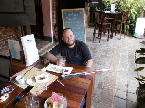 Tony relaxing with a drink at a café/restaurant in the grounds of Fort Zeelandia.