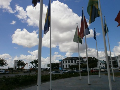 Looking towards the Suriname River - more flags.