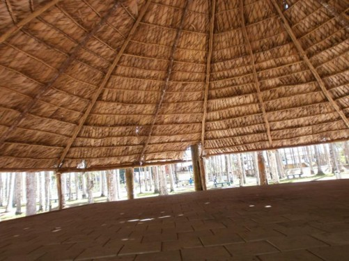 A large shelter within the palm garden. The roof thatched with palm fronds.