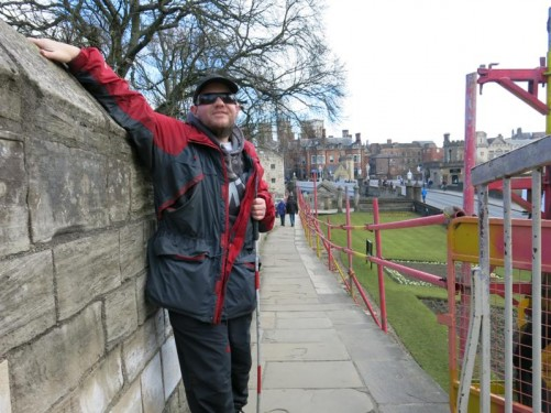Tony on a path by the city walls. Behind is the Lendal Bridge over the River Ouse leading into the centre of York.