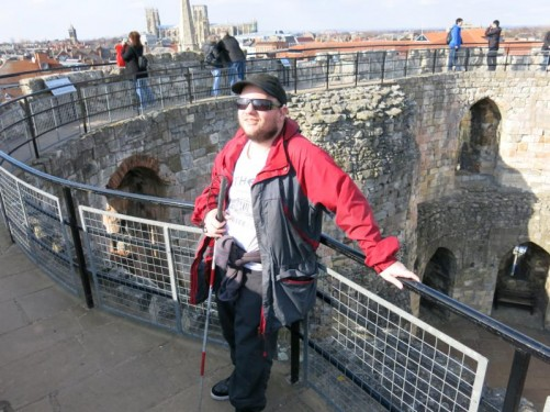 Tony on the roughly circular walkway around the battlements on top of Clifford's Tower. Again views of the city around.